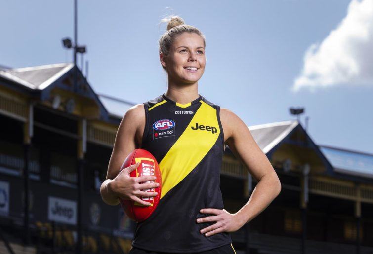 Richmond recruit Katie Brennan poses with the football.