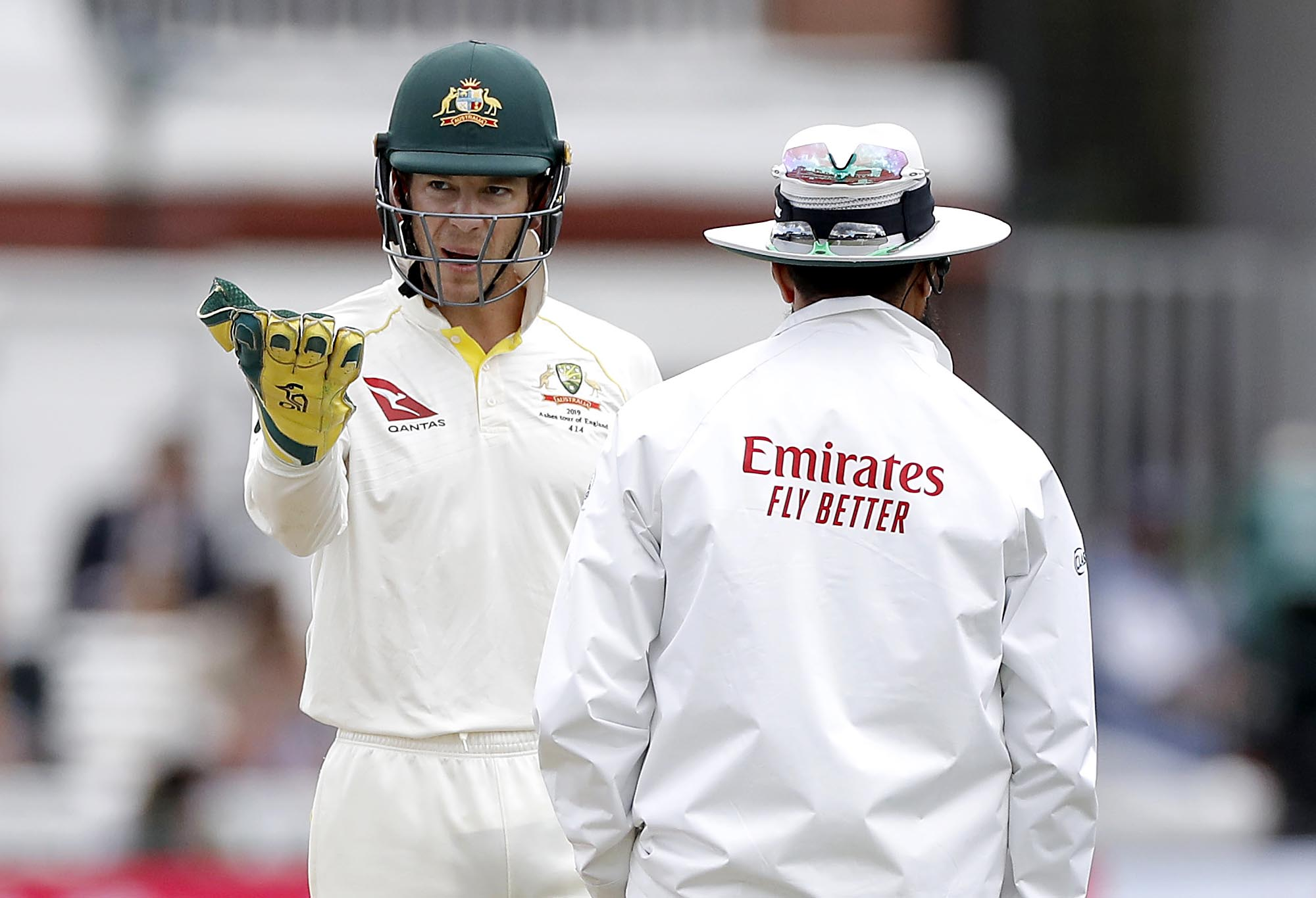 Tim Paine speaks to umpire Aleem Dar