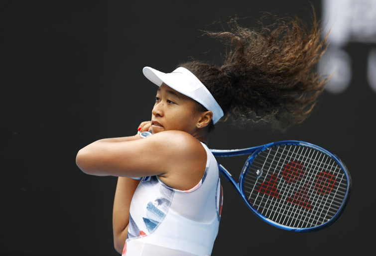 Naomi Osaka plays a backhand