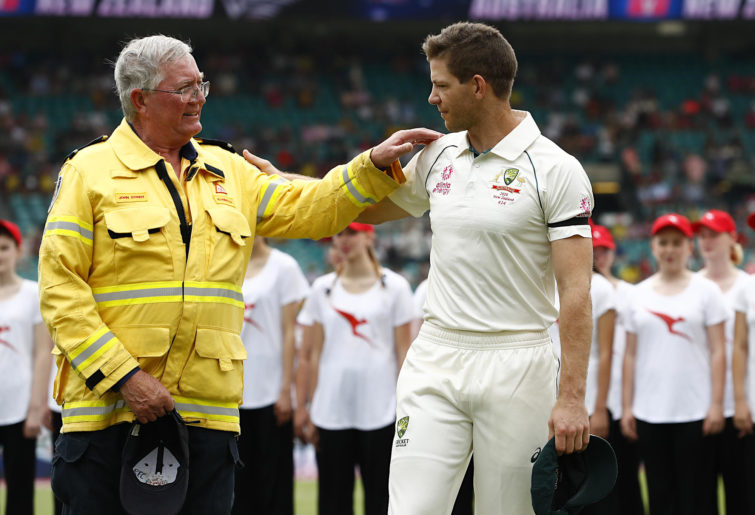 Tim Paine speaks to a Fire Brigade Volunteer