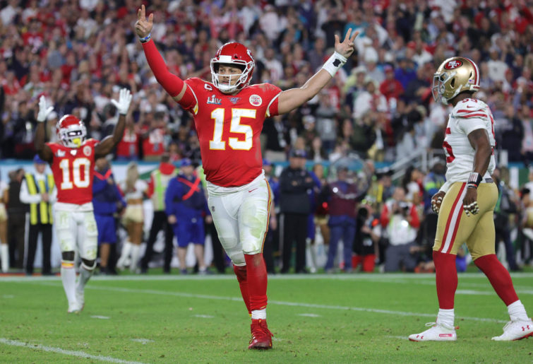 Patrick Mahomes #15 of the Kansas City Chiefs celebrates after throwing a touchdown pass