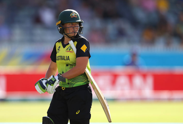 Alyssa Healy walks off after being bowled