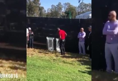 Tiger Woods retrieves a golf ball out of the trash in truly bizarre moment