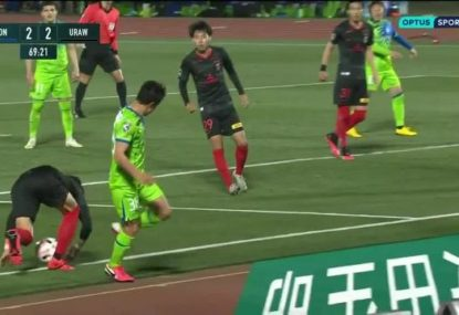 Japanese player gets caught with one of the most blatant handballs you'll see