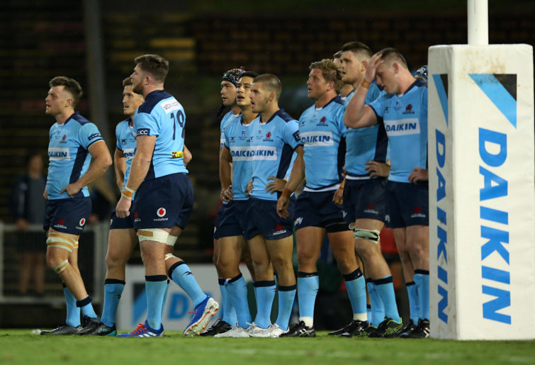 Waratahs players react after a Super Rugby loss