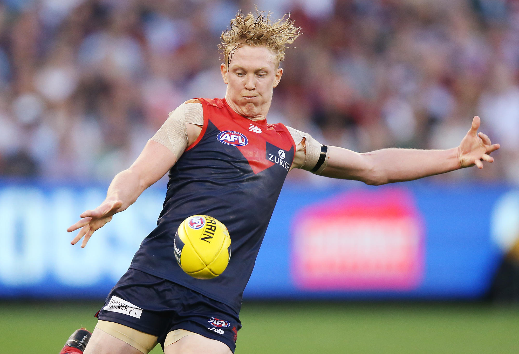 Clayton Oliver of the Demons kicks the ball