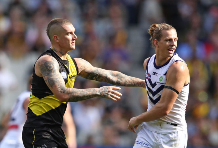 Dustin Martin of the Tigers and Nat Fyfe of the Dockers compete for the ball