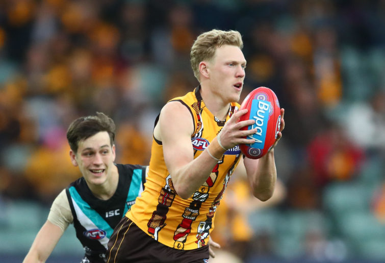 James Sicily of the Hawks runs with the ball