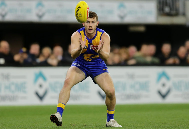 Luke Shuey of the Eagles looks to mark the ball