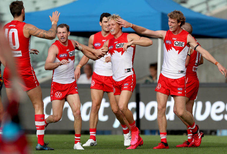 Isaac Heeney celebrates a goal
