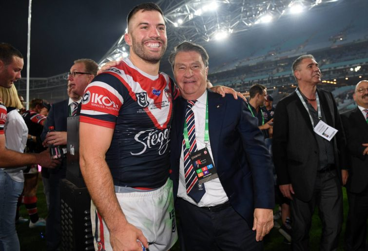 James Tedesco of the Roosters celebrates with Roosters Club Chairman Nick Politis