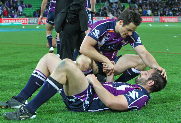 Adam Woolnough with Cooper Cronk after his final NRL game