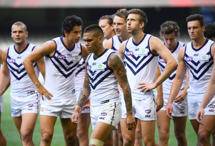 The Dockers look a bit dejected after losing