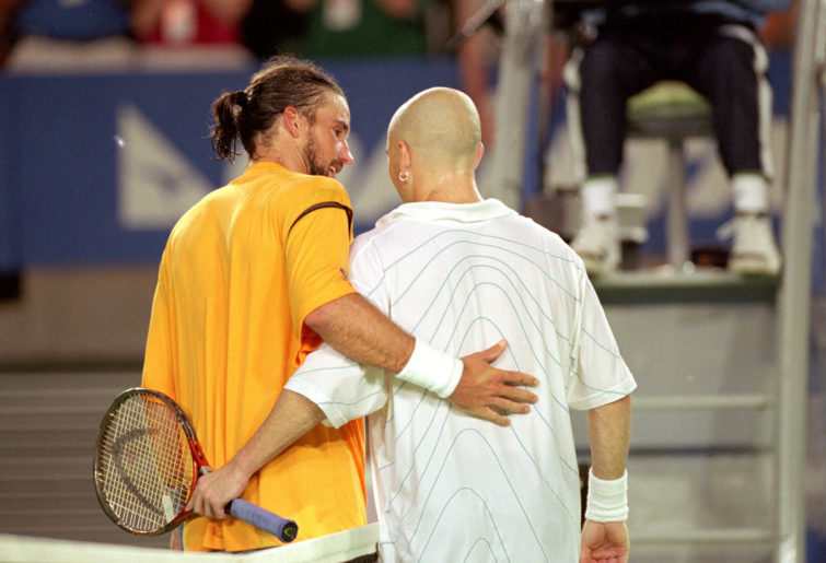 Pat Rafter (left) of Australia congratulates semi-final winner Andre Agassi