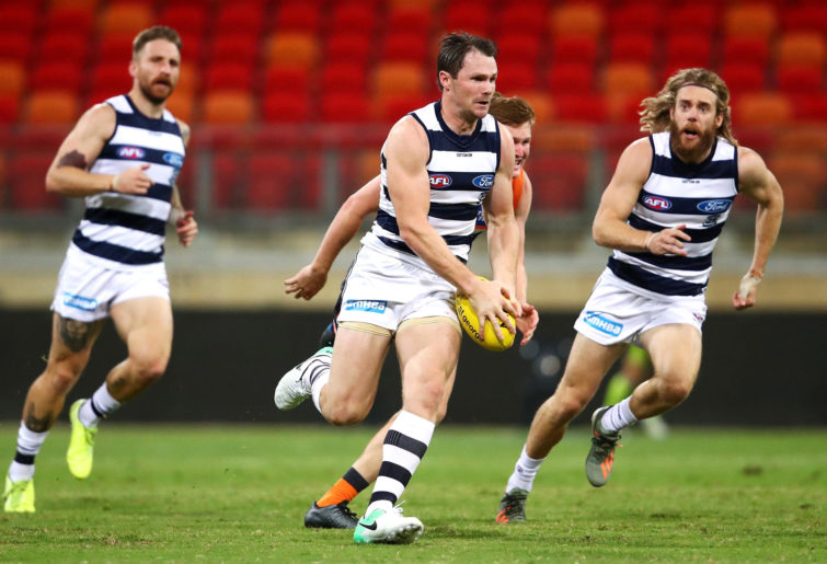 Patrick Dangerfield of the Cats makes a break