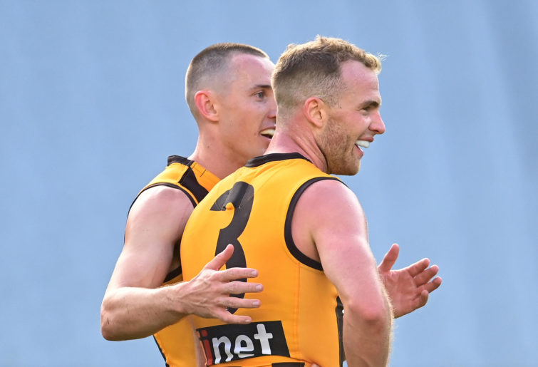 Tom Scully and Tom Mitchell of the Hawks celebrate winning