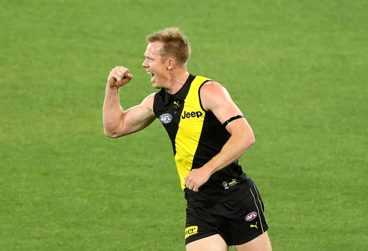 Jack Riewoldt of the Tigers celebrates kicking a goal