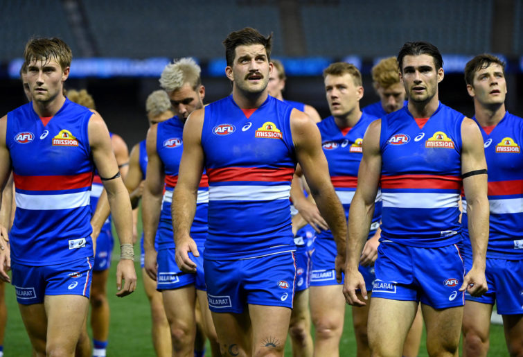 The Bulldogs look dejected after losing the round 1 AFL match