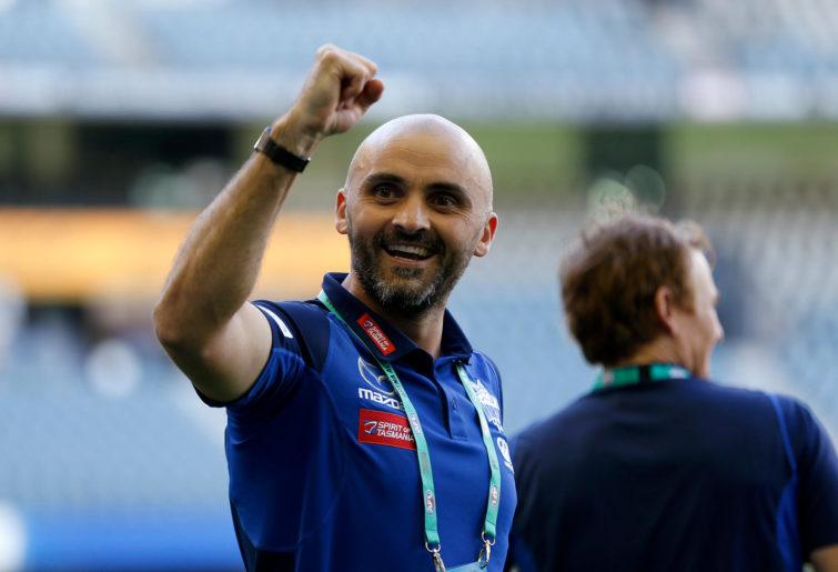 Rhyce Shaw, Senior Coach of the Kangaroos celebrates his team win