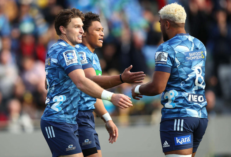 Beauden Barrett celebrates with Blues teammates