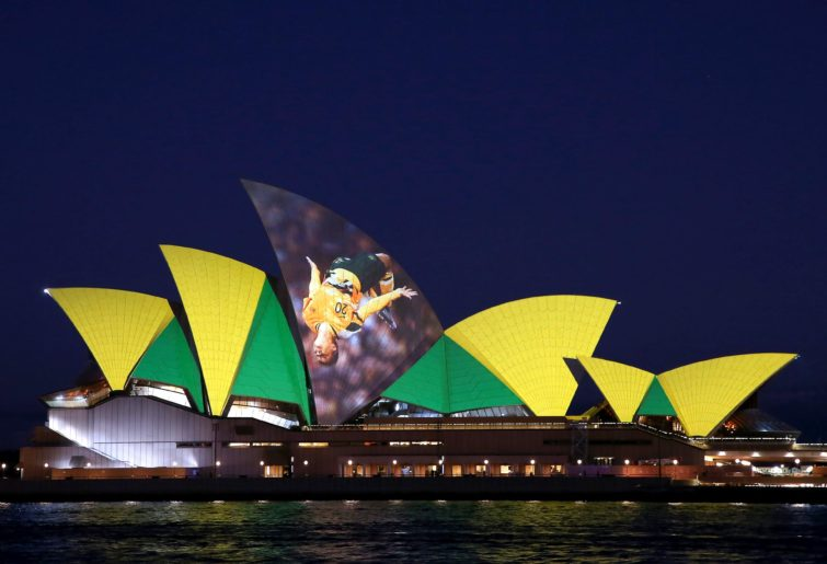 The Sydney Opera House lit up in green and gold