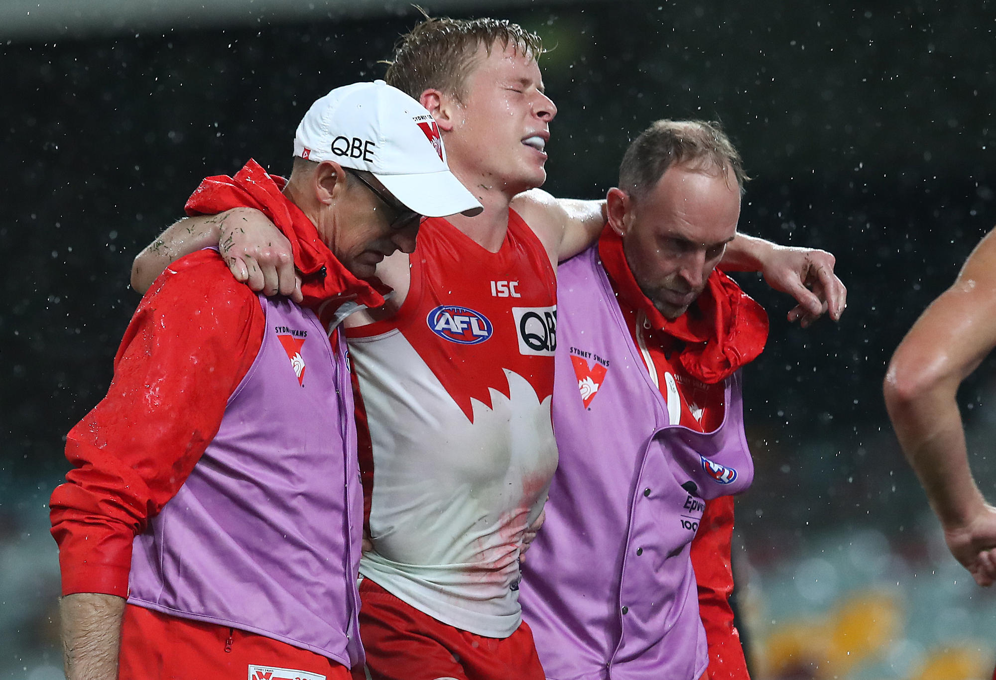 Isaac Heeney of the Swans is carried off injured