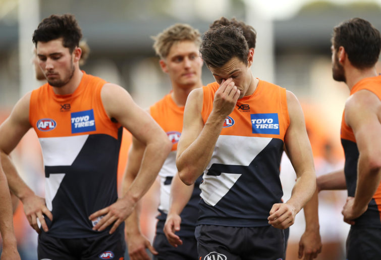 Josh Kelly of the Giants looks dejected