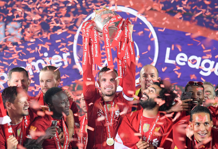 Jordan Henderson of Liverpool holds the Premier League Trophy aloft