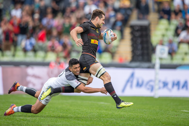 Germany's Robert Haase is tackled by Ngarohi McGarvey-Black