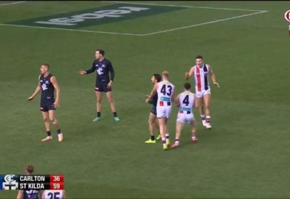 Peak local footy as Saint blocks teammate from taking the advantage on his shot at goal