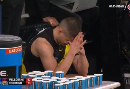 Dion Prestia in tears on the bench after suffering suspected serious knee injury