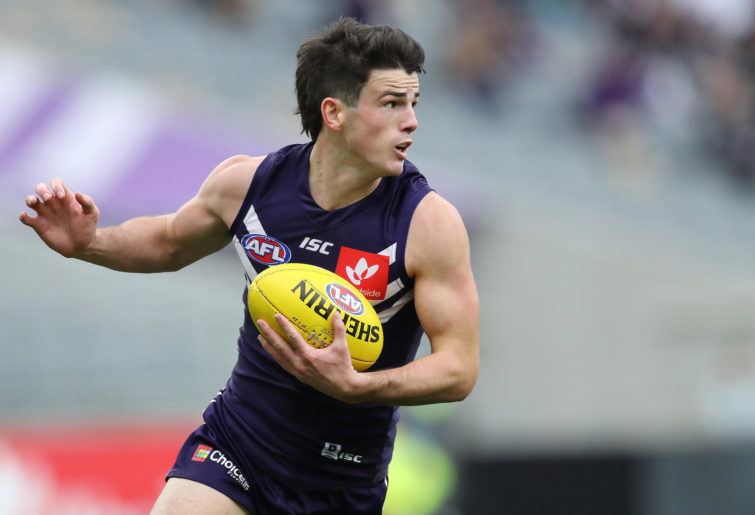 Andrew Brayshaw of the Dockers looks to pass the ball