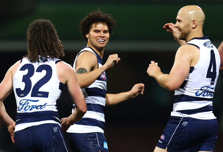Brandan Parfitt of the Cats celebrates kicking a goal