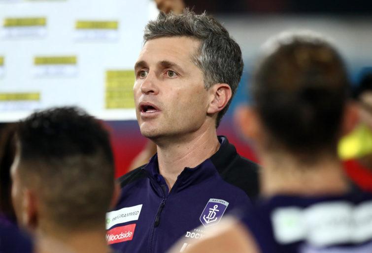 Dockers coach Justin Longmuir talks to his team