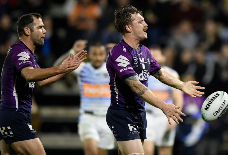 Cameron Munster and Cameron Smith celebrate a try