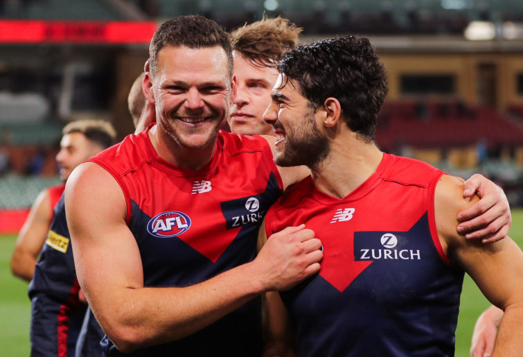 Steven May and Christian Petracca of the Demons celebrate victory