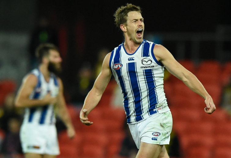 Trent Dumont of the Kangaroos celebrates kicking a goal