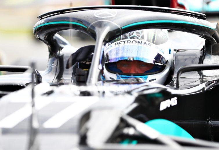 Valtteri Bottas sits in his car