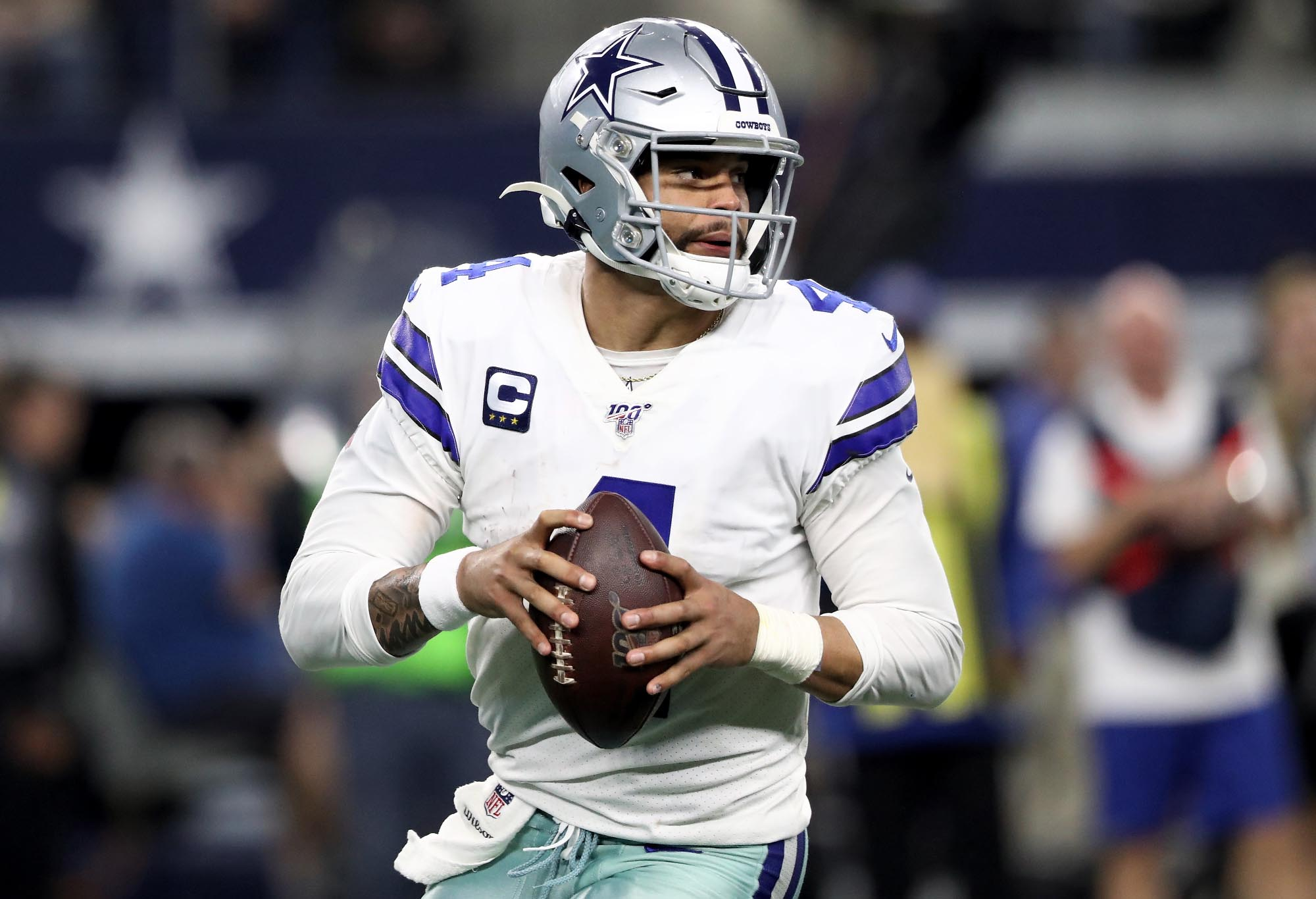 Dak Prescott runs with the ball