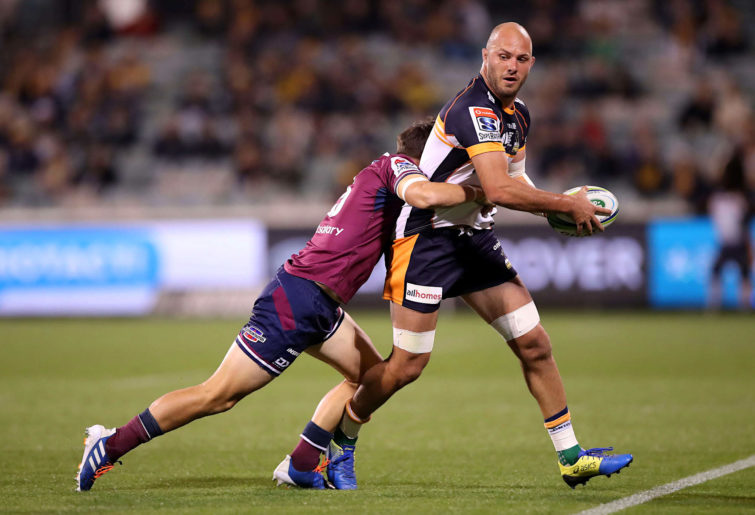 Lachlan McCaffrey of the Brumbies is tackled