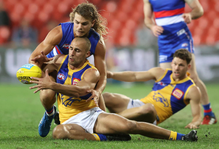 Bailey Smith of the Bulldogs and Dom Sheed of the Eagles compete