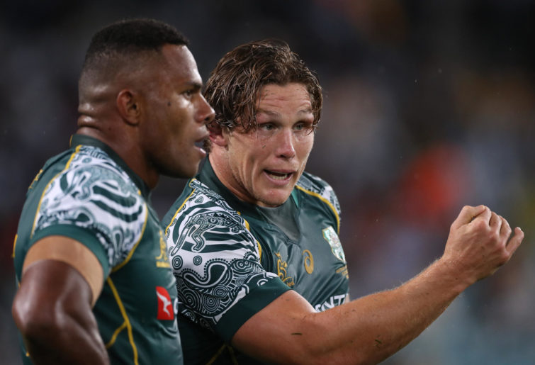 Michael Hooper of the Wallabies talks with Filipo Daugunu
