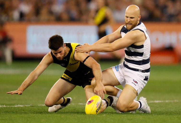 Gary Ablett of the Cats and Trent Cotchin of the Tigers compete for the ball