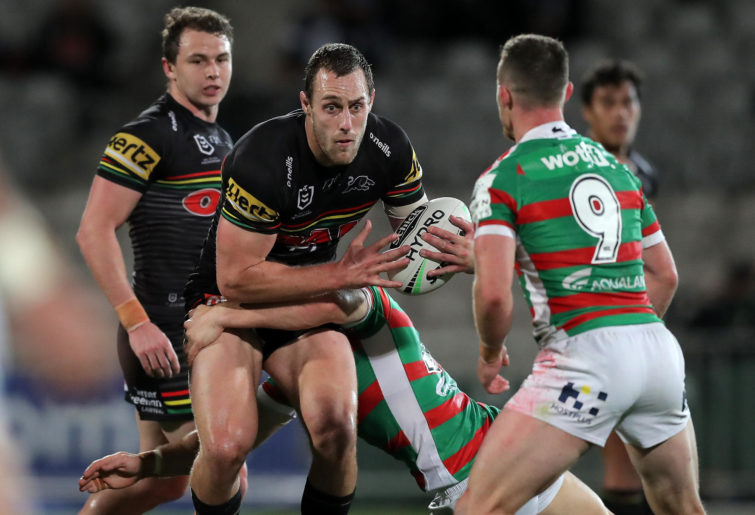 Isaah Yeo of the Panthers is tackled