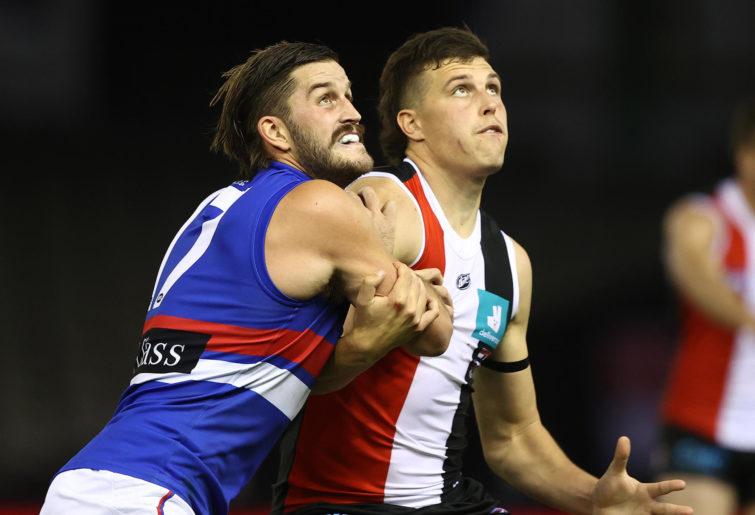 Josh Bruce of the Bulldogs is challenged Rowan Marshall of the Saints