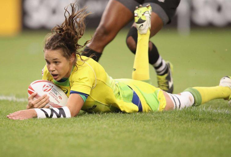 Chloe Dalton of Australia scores a try
