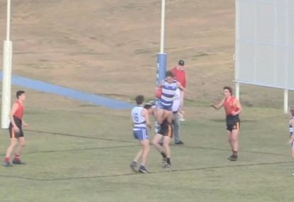 Schoolboy footy star's sensational high-flying grab is majestic