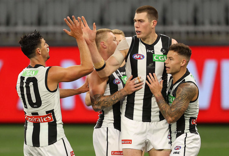 Mason Cox and the Magpies celebrate