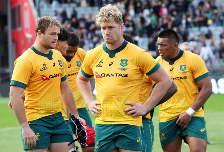 Matt Philip of the Wallabies and teammates look dejected