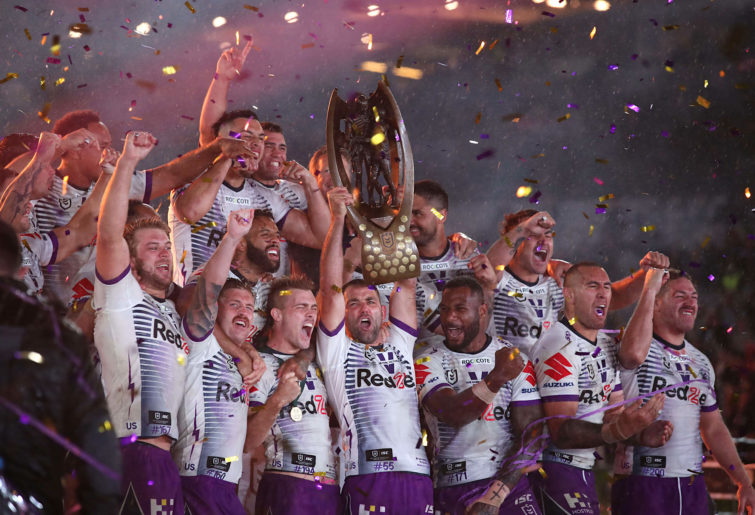 Cameron Smith of the Storm lifts the Premiership Trophy